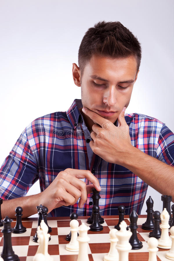 Free Young Chess Player Thinking About His Next Move Royalty Free Stock Image - 26398726