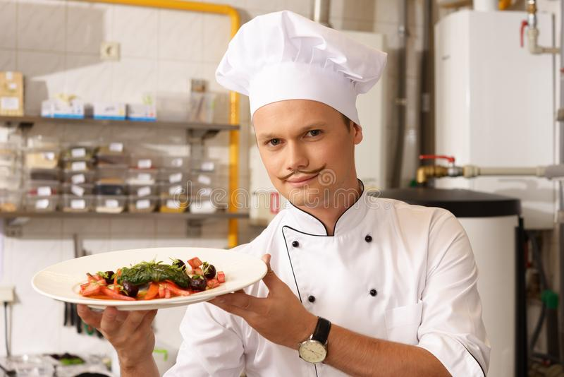 Young chief on kitchen in restaurant stock images