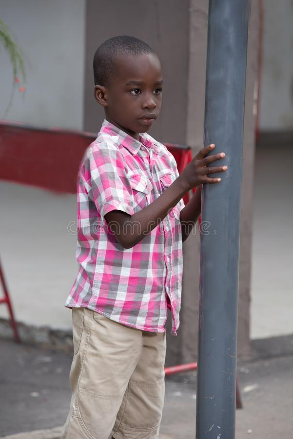 Young child alone on the street royalty free stock photos