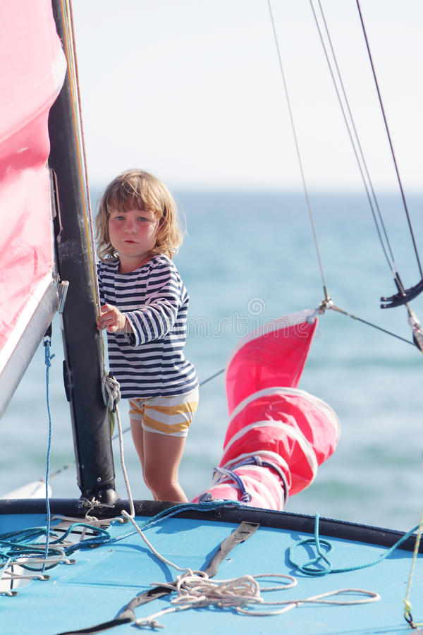 Download Young Child On Board Of Sea Yacht Stock Photo - Image: 26276418