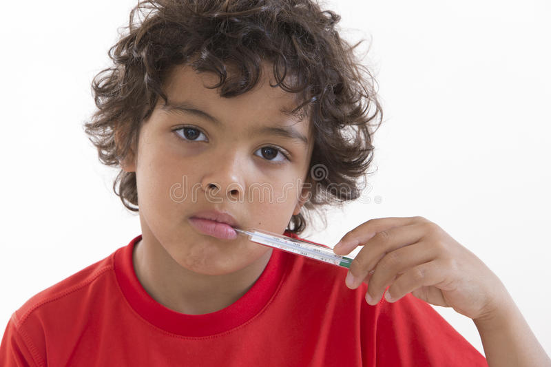 Young child with a digital thermometer stock photography