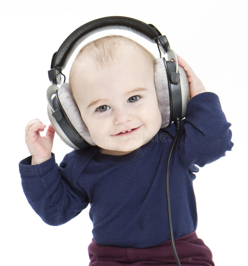 Download Young Child With Ear-phones Listening To Music Stock Photo - Image: 24061172