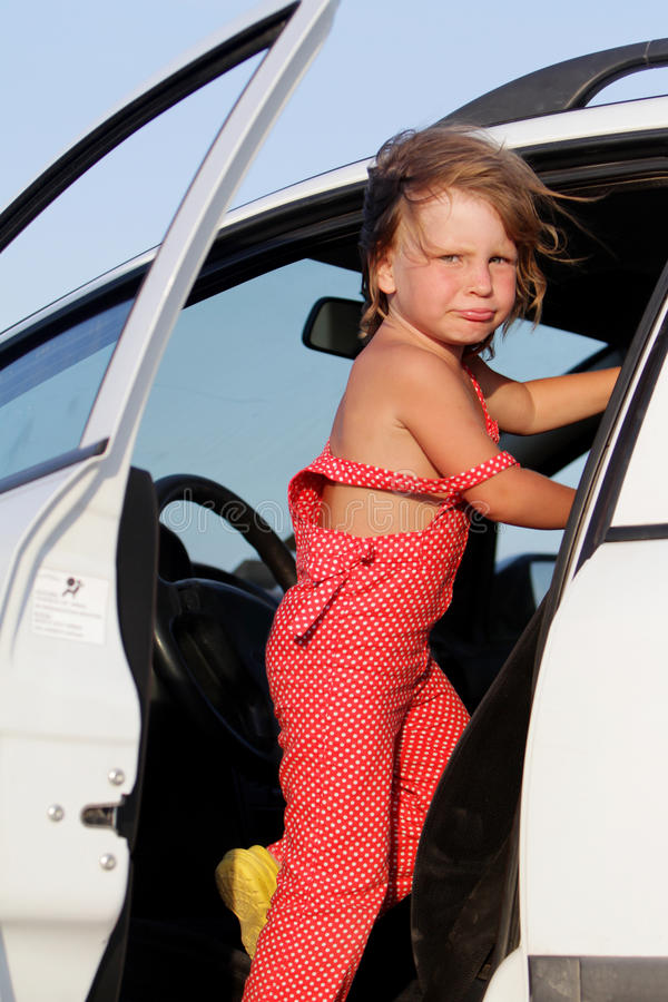 Young Child Girl Getting Ready For Car Trip Royalty Free Stock Photos