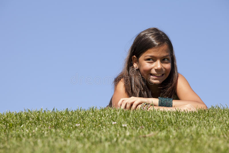 Young child on the grass stock image