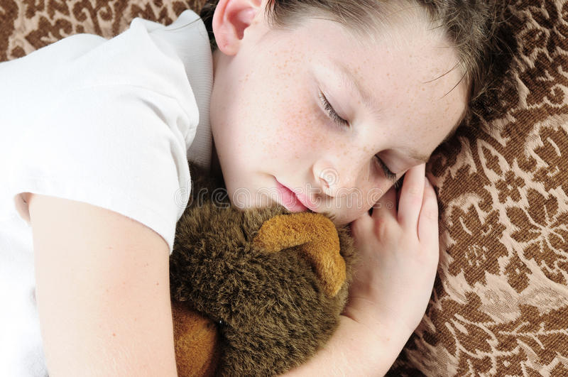 Young child napping royalty free stock photos