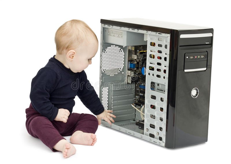 Young child with open computer. Young child in blue shirt with open computer on white background stock photo