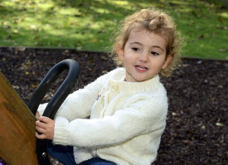 Download Young Child Outdoors Having Fun On A See-saw. Stock Image - Image: 39180795