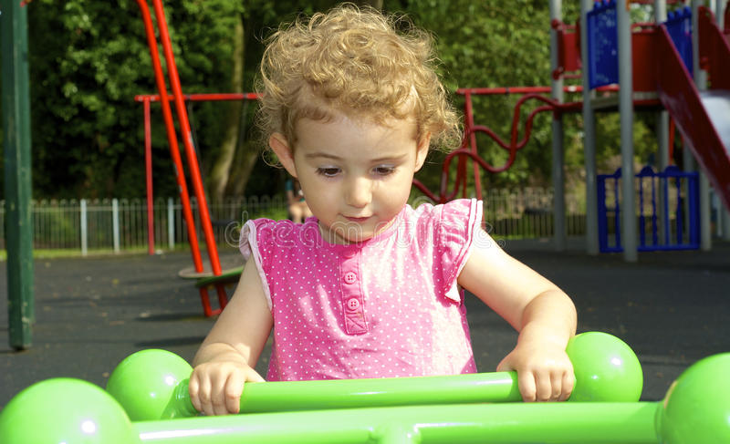 Download Young Child Playing On See-saw At The Playground. Stock Photo - Image: 33780932