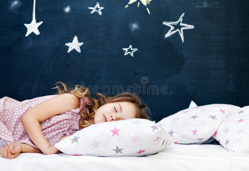 Young child sleeping stock photos
