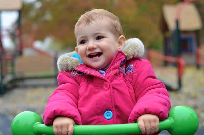 Download Young Child, Smiling, Playing On A See-saw At The Stock Image - Image: 33622433