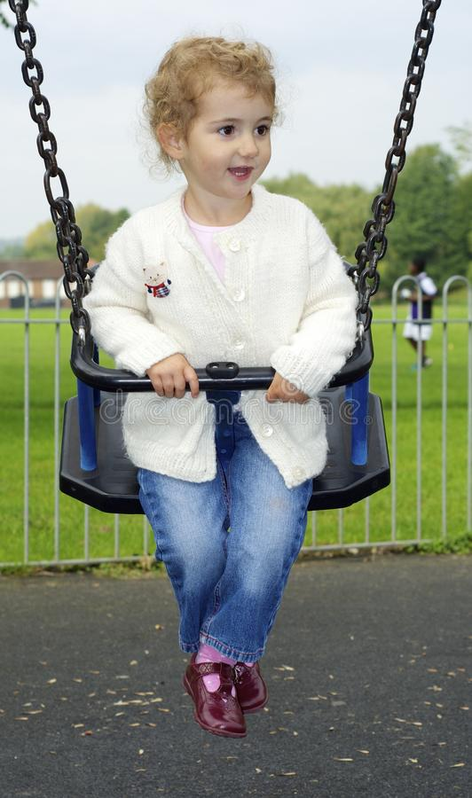 Young Child On A Swing Stock Images