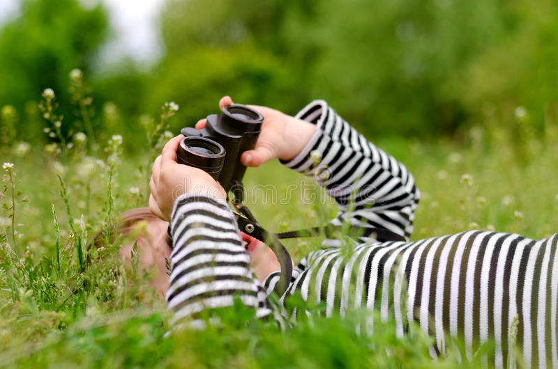 Young child using a pair of binoculars royalty free stock photo