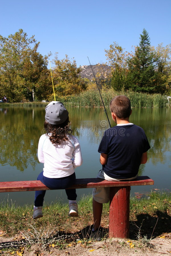 Young children fishing royalty free stock photography