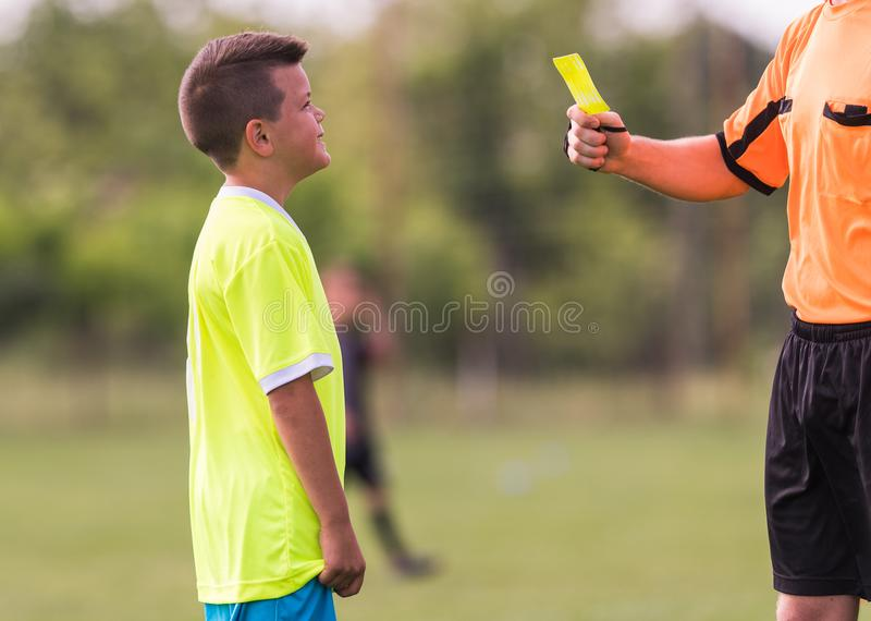 Young children player gets penalty in soccer game stock photography