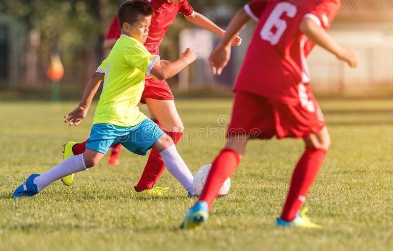 Young children players football match on soccer field royalty free stock images