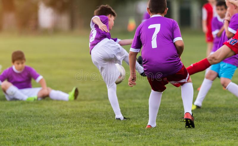 Young children players football match on soccer field royalty free stock photos