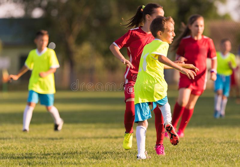 Young children players football match on soccer field stock photo