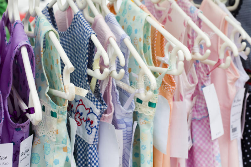 Young childrens girl clothes. Bright floral cotton girls dresses royalty free stock photography