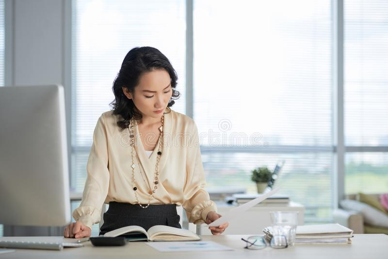 Business woman working with papers stock photo