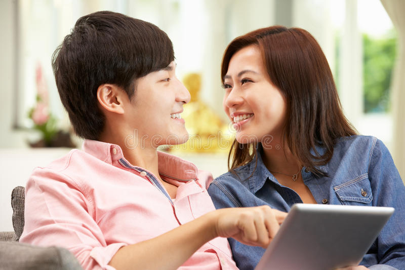 Young Chinese Couple Using Digital Tablet royalty free stock images