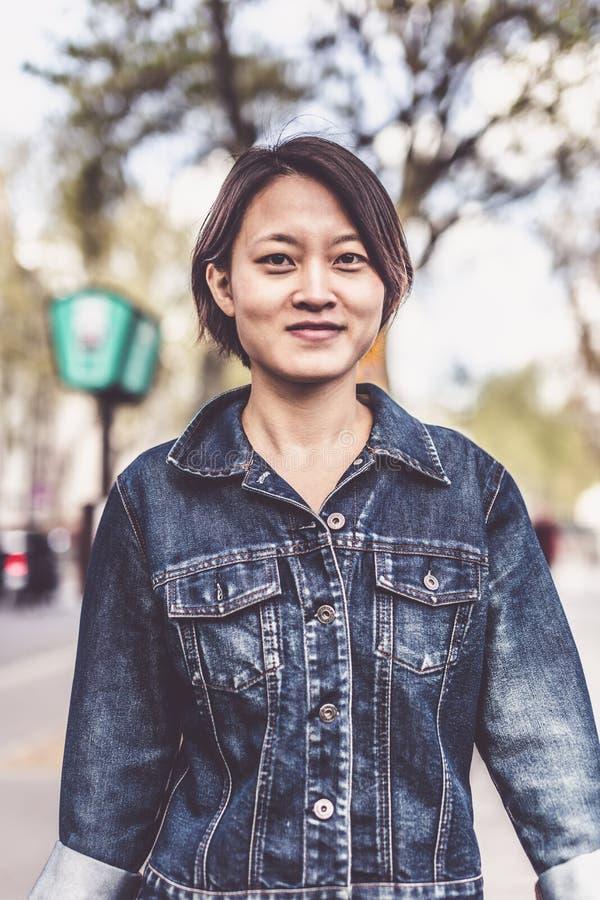 Young Chinese Female Enjoying Trip To Paris royalty free stock photo