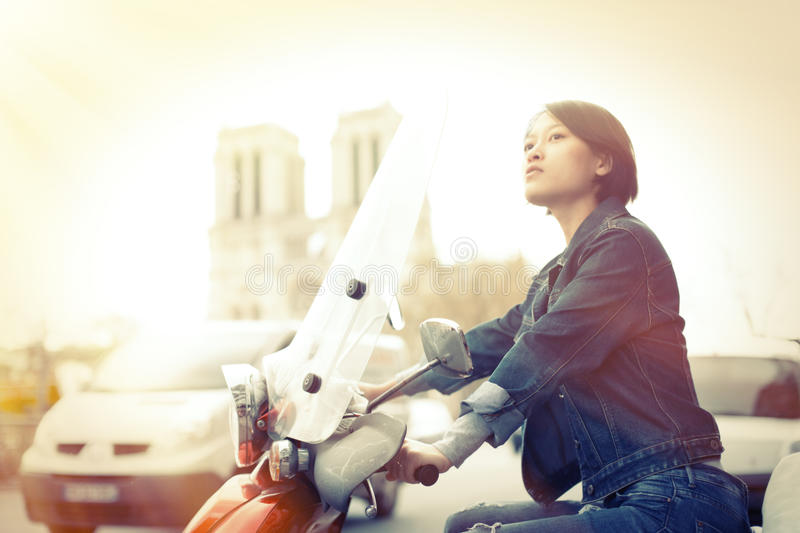 Young Chinese Female On Scooter stock photos