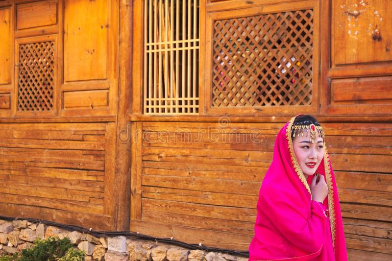Young chinese girl with an ancient dress in the streets of Lijiang Yunnan, China stock photography