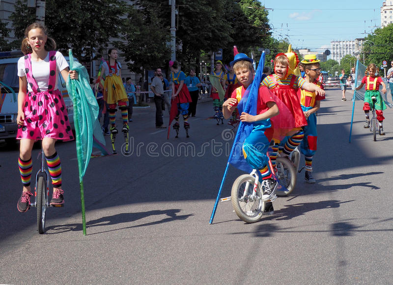Young circus performers on cycles royalty free stock photography