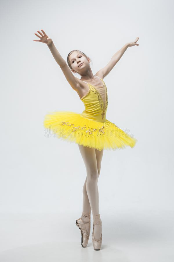 Young classical dancer on white background. stock image