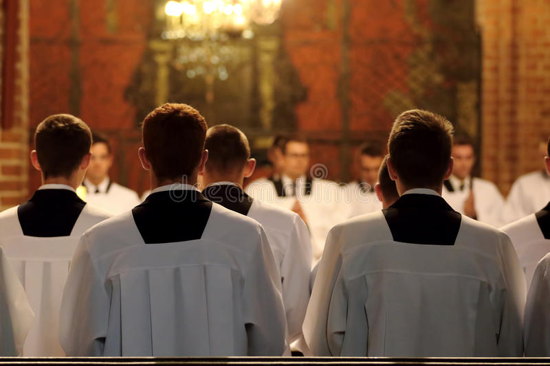 The young clerics of the seminary during Mass.  stock image