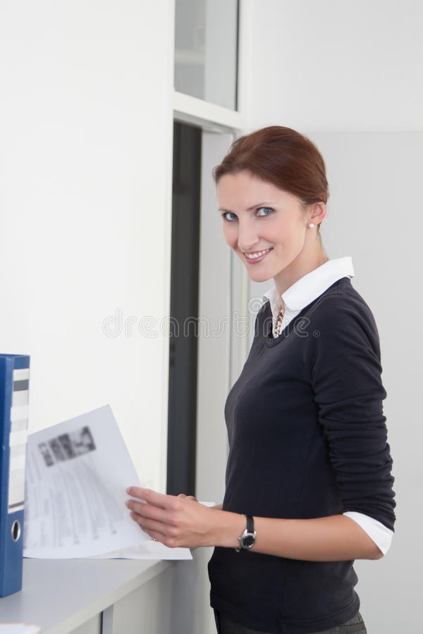 Download Young Clerk Checks Documents Stock Photo - Image of administer, blouse: 27051868
