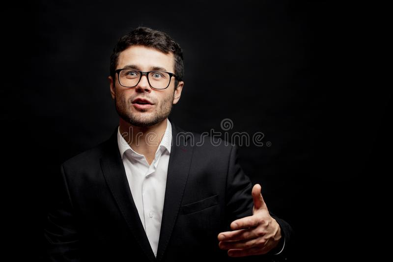 Young clever man is arguing logically. cute man with a powerful talking point stock image