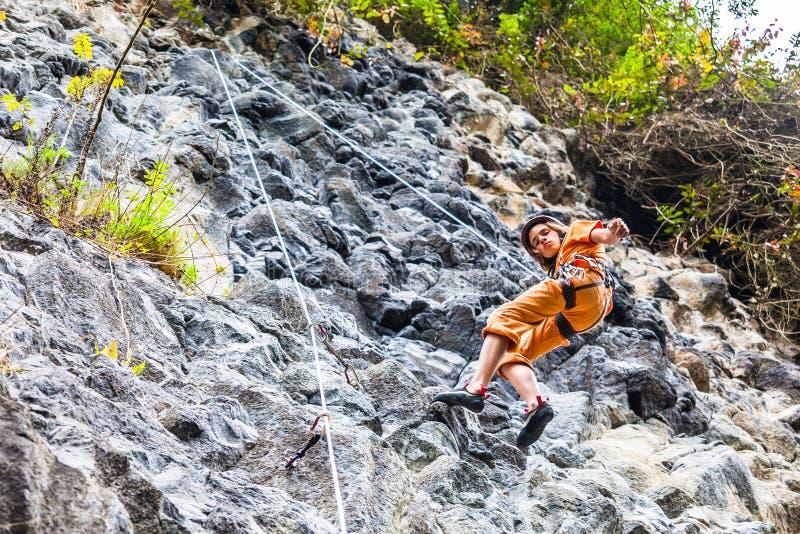 Young climber. Descending a rock wall at Cuyuja royalty free stock image