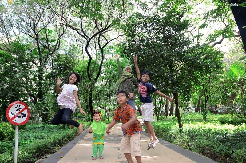 Young jump. Some child playing at Kebun Bibit, garden city of Surabaya, East Java, Indonesia. Photo taken July 4th, 2013 stock images