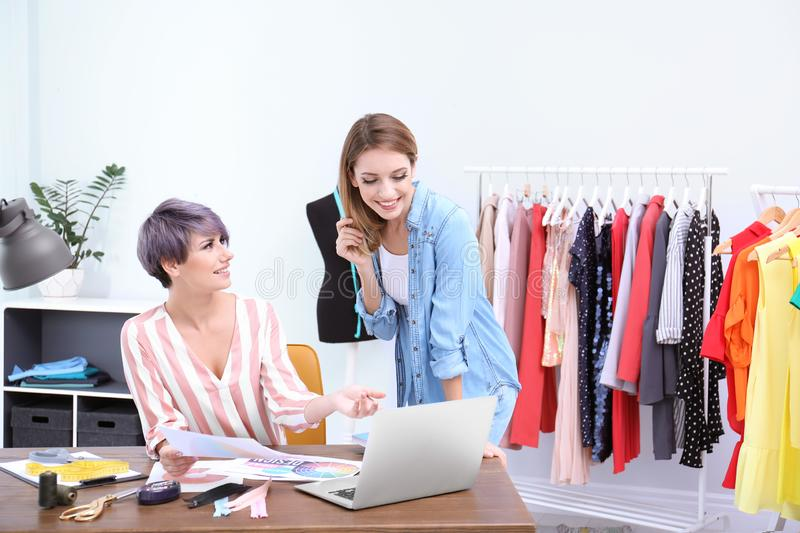 Young clothes stylist speaking with customer royalty free stock photography