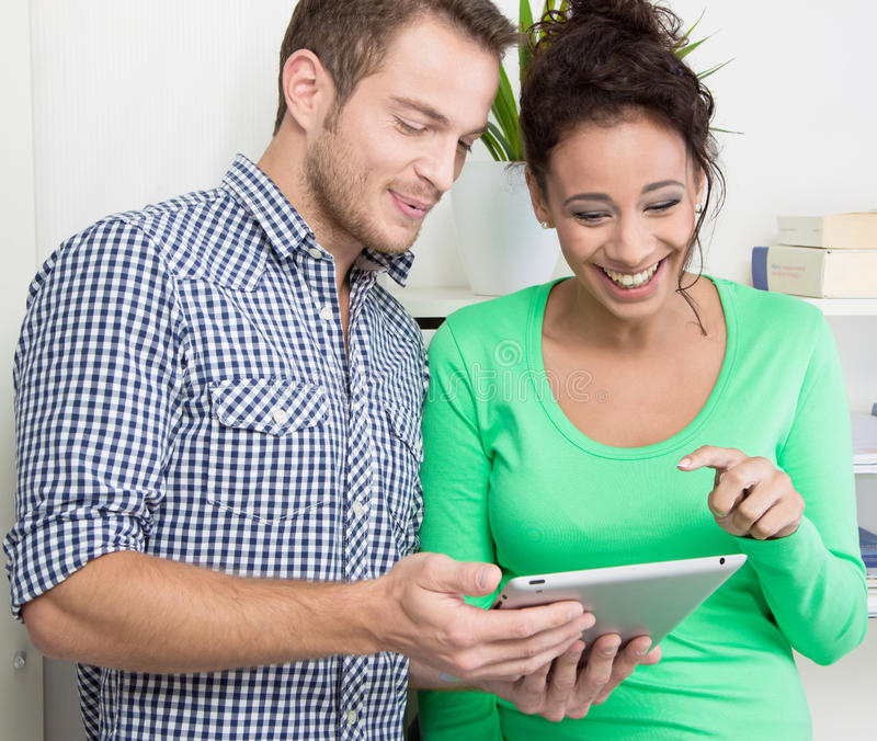 Download Young Colleagues Flirting In The Office Stock Photo - Image: 36260360
