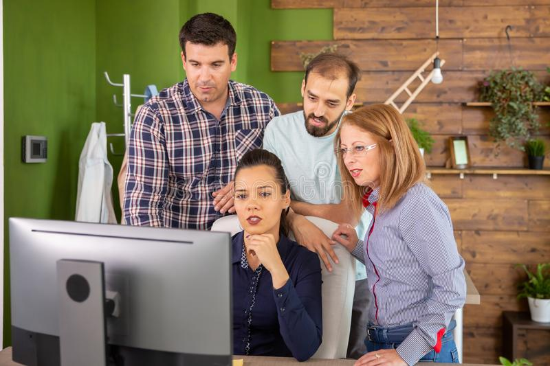 Young colleagues having a conversation with their female manager stock image