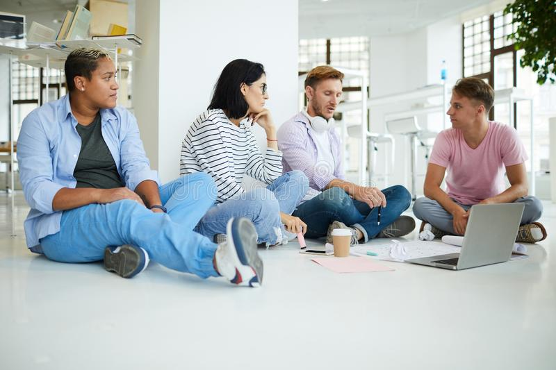 Young colleagues working on creative project together royalty free stock photos