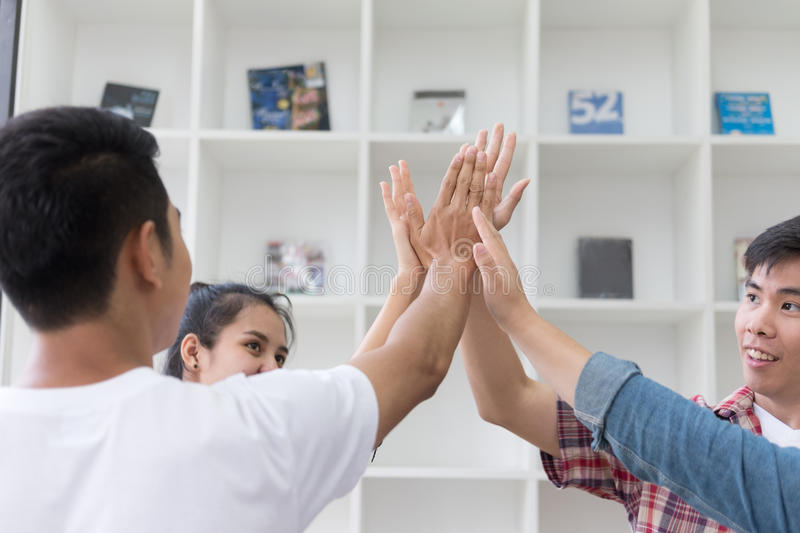 young college student joining hand, business team touching hands royalty free stock photos