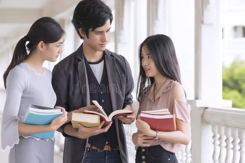 Young college students studying in university. royalty free stock images