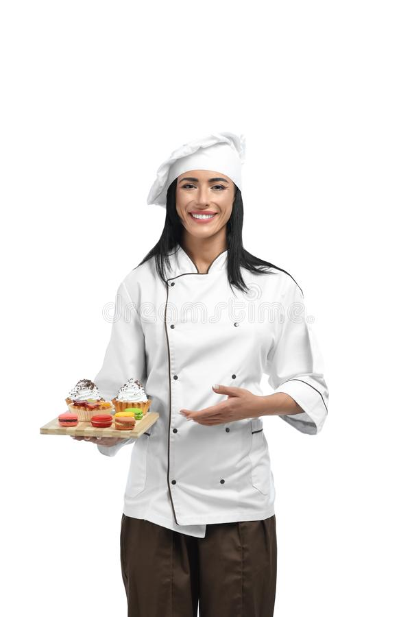 Young confectioner in professional clothes liking her job. royalty free stock image