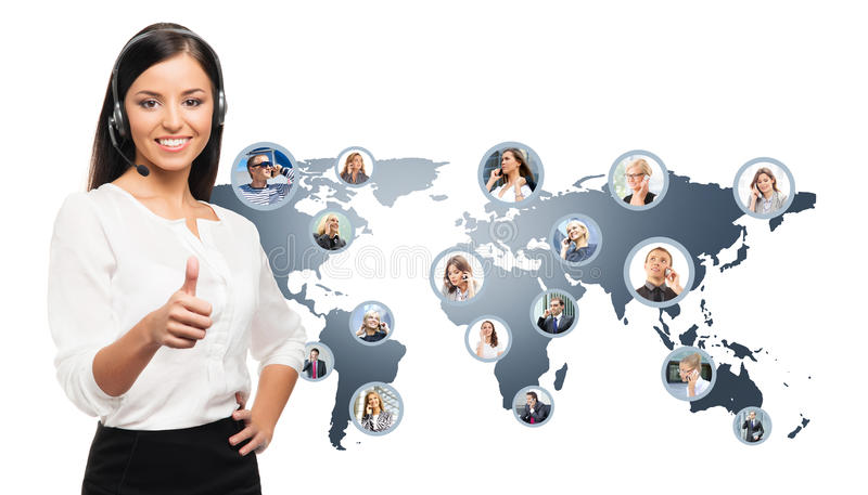 Young, confident and beautiful customer support operator. Working in a call center. World map on a background. International call center concept stock image