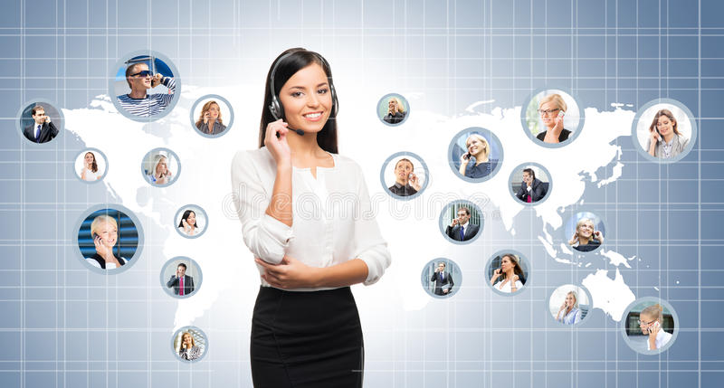 Young, confident and beautiful customer support operator. Working in a call center. World map on a background. International call center concept stock photography