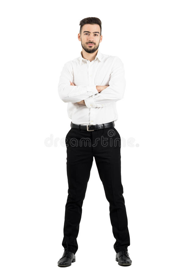Young confident business man with crossed arms looking at camera. stock photography