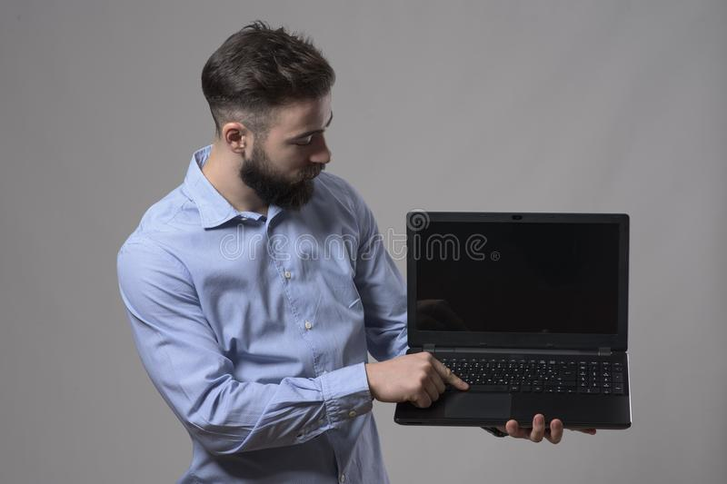 Young confident business man or programmer using computer and watching laptop monitor stock images