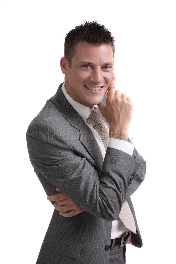 Young confident businessman. Isolated portrait of a young, smiling and confident businessman royalty free stock image