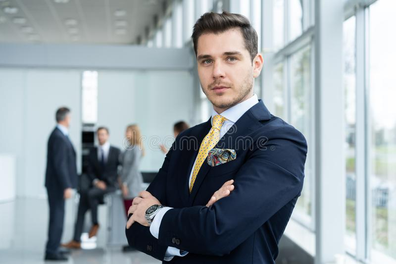 Young and confident businessman. Handsome young man in formalwear smiling at camera royalty free stock photography
