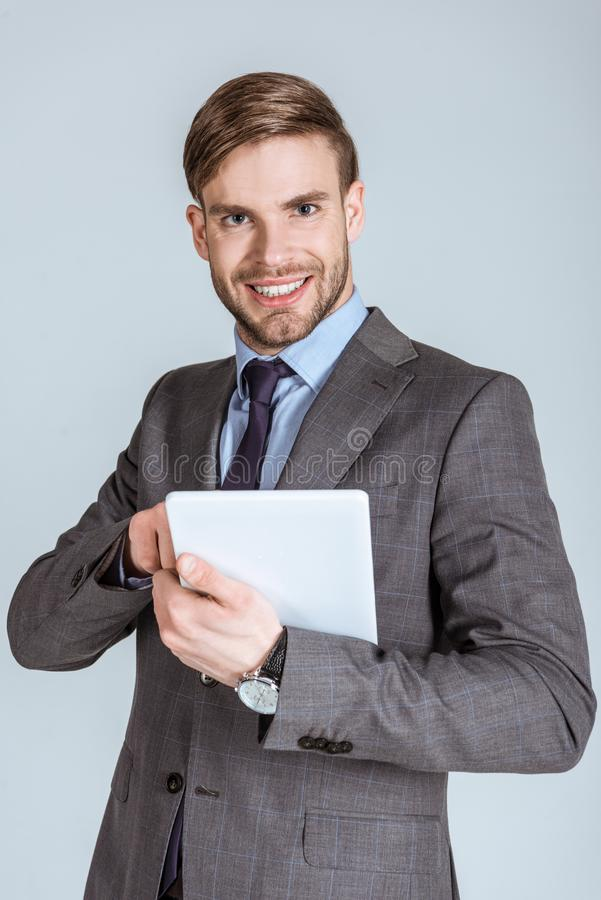 Young confident businessman using digital tablet stock images