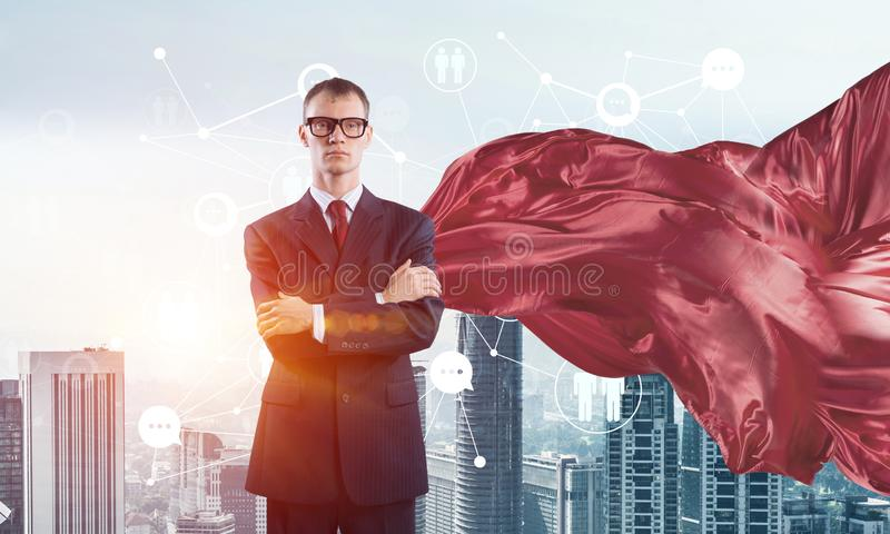 Concept of power and sucess with businessman superhero in big city stock photos