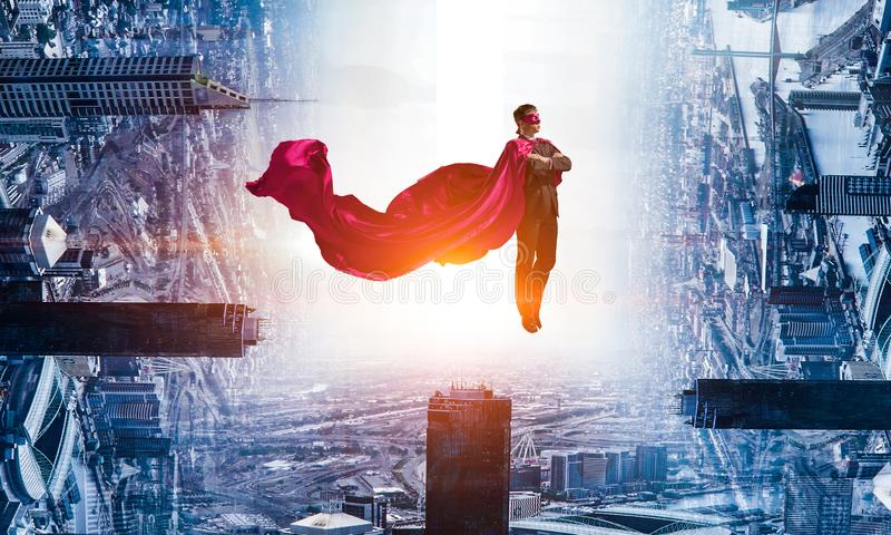 Super man in sky royalty free stock photo